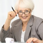 Businesswoman mature with calculator